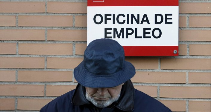 A man looks down as he waits in line to enter a government-run employment office in Madrid in this January 24, 2013