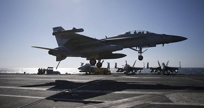 A U.S. Navy F/A-18 Super Hornet fighter lands on the deck of the USS Ronald Reagan during a joint naval drill between South Korea and the U.S., in the West Sea, South Korea, October 29, 2015
