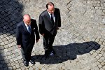 French President Francois Hollande (R) and French Interior Minister Bernard Cazeneuve (L) take part in a minute of silence at the Hotel de Beauvau in Paris, France, July 18, 2016 on the third day of national mourning to pay tribute to victims of the truck attack along the Promenade des Anglais on Bastille Day that killed scores and injured as many in Nice.