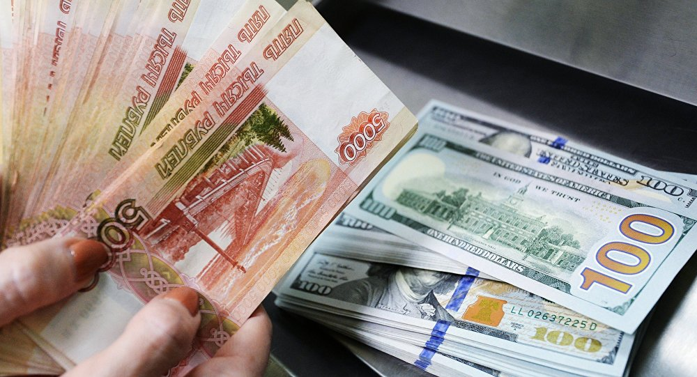 US dollars and rubles inside a currency exchange office of a Sberbank