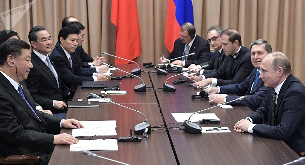 Russian President Vladimir Putin and Xi Jinping, President of the People's Republic of China (PRC), at a meeting in Astana